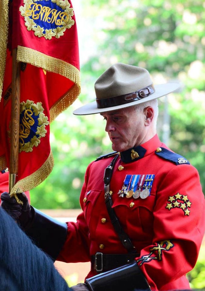 Sergeant Major Bill Stewart, an old school frontiersman, carries the Guidon for Canada; Hyde Park Barracks, Knightsbridge - Royal Canadian Mounted Police in London for the Queen's Diamond Jubilee - with Royal Household Cavalry Mounted Regiment