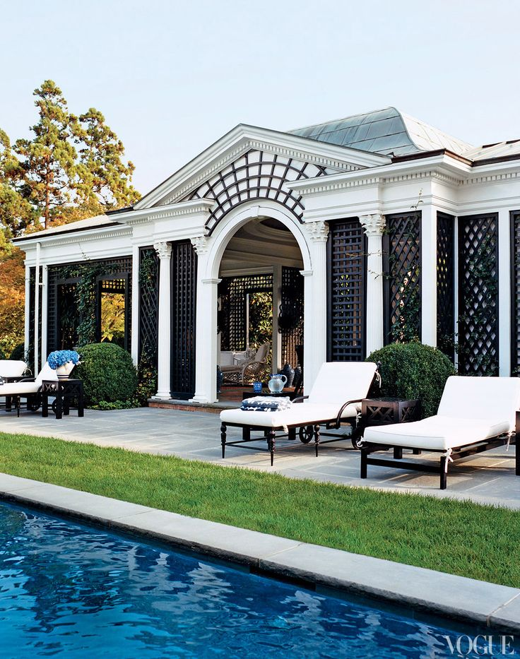 Black trellis defines the Tory Burch pool pavilion that was original to the house. (Black + white + green)