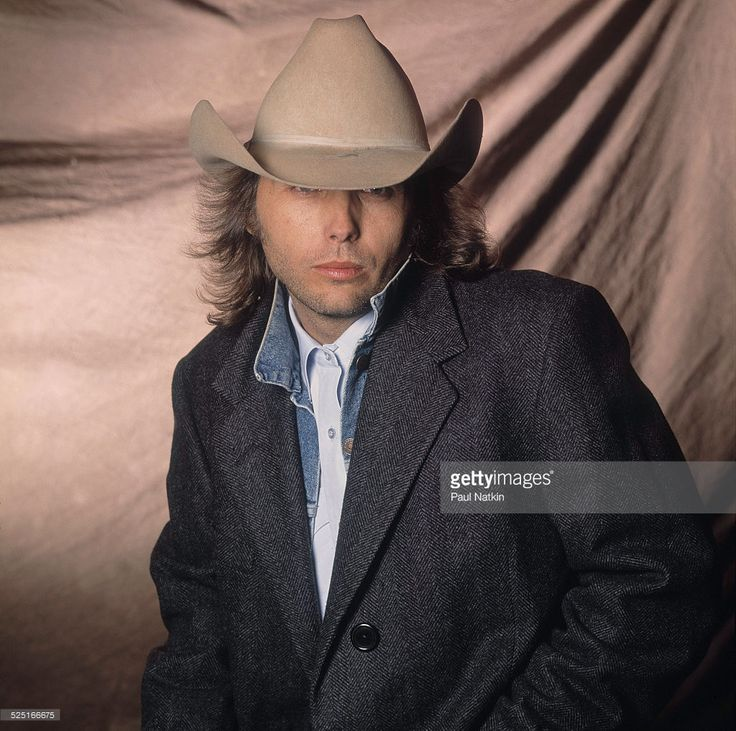 Portrait of country musician Dwight Yoakum at Farm Aid, Ames, Iowa, April 4, 1990.