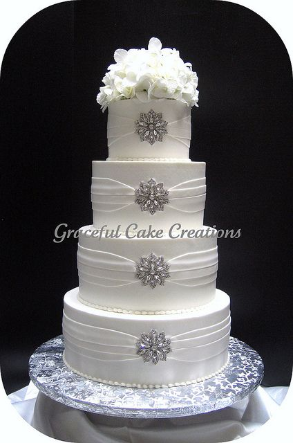 Elegant White Wedding Cake with Silver Brooches by Graceful Cake Creations, via Flickr
