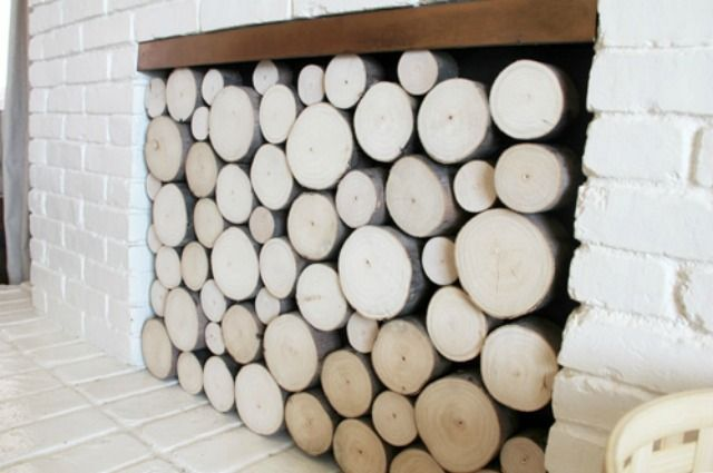 Try one of these unique ways to dress your fireplace, whether with a clever facade, a re-purposed screen, a grouping of candles or a fireplace screen that suits your style.