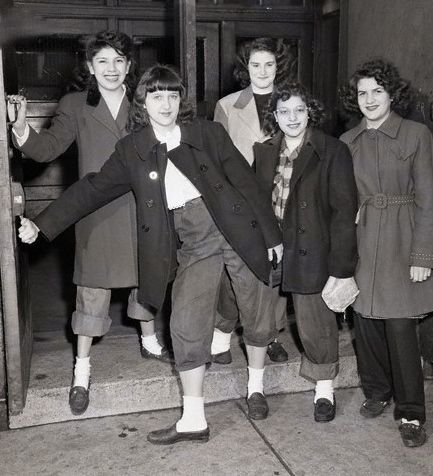 """Group of girls being sent home from McKinley High School for wearing """"dungarees"""" and """"slickers,"""" 1946, Chicago."""