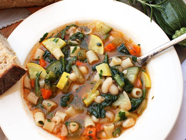 If all were right in the world, there would be as many recipes for minestrone—the Italian soup of simmered mixed vegetables and beans—as there have been individual pots of it cooked. That's because it's really more of a process than a fixed recipe. It's a hearty, easy, delicious meal that you can make with a couple of pantry staples and whatever fresh vegetables you happen to have on hand.