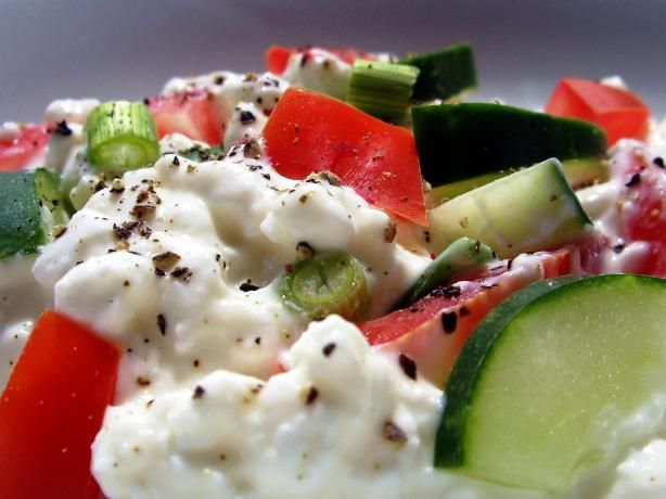 Cottage Cheese salad with tomato, cucumber and greed diced onion or diced red onion.