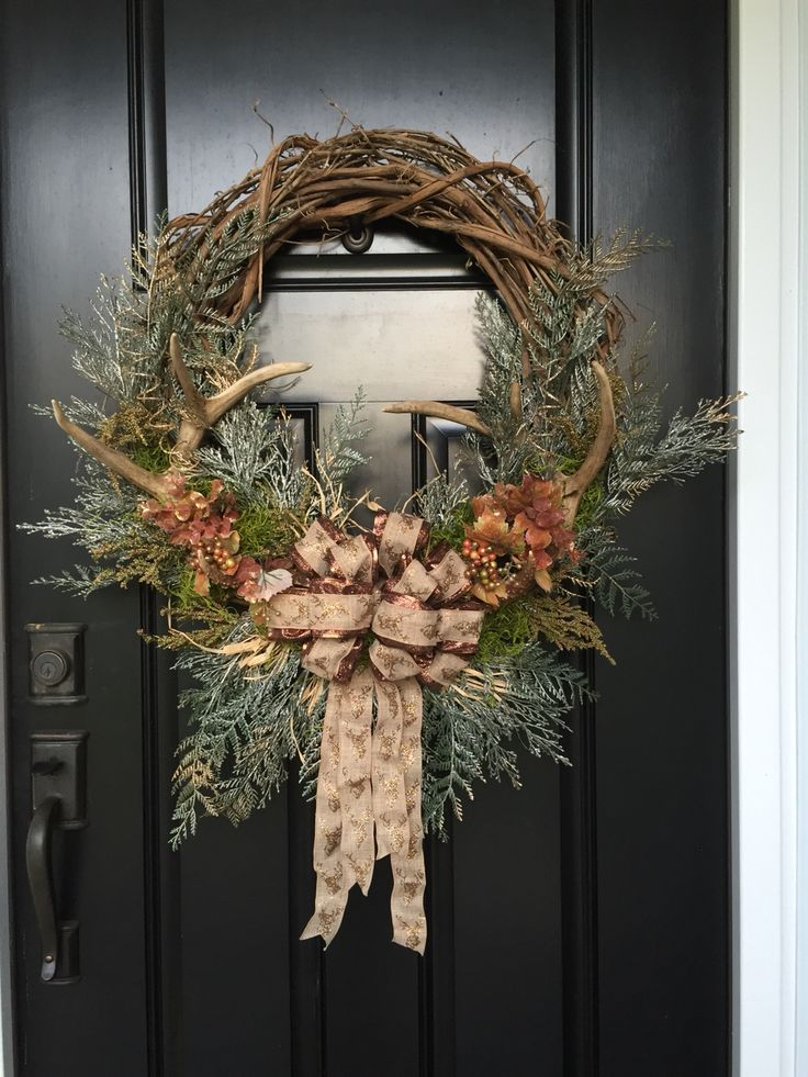 Rustic fall or winter wreath with antlers in a grape vine wreath with Green pines...grasses...leaves...and deer ribbon bow