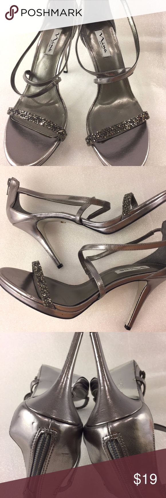 """Nina 10M Womens Strappy Heel Silver Jewel Zip For sale is a pair of strappy heels by Nina New York. There is a zipper on the back of the shoe. These are in great condition and have very little wear.   Size: 10M Length: 9.5"""" from heel to front of toe Width: 3.25"""" at widest part of sole Heel: 4""""  I'll ship within 24 hours  Thank you Nina Shoes Heels"""