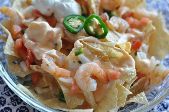 Red Lobster Shrimp Nachos | CopyKat Recipe... combination of Cheddar and Monterey Jack cheese served over crisp nacho chips, and then topped with pico de gallo and shrimp. I almost think you can make a meal out of this and another one of their other appetizers for a complete meal. Their cheese that tops these nachos is thick and creamy and so much better than just a cheddar cheese sauce.    ..