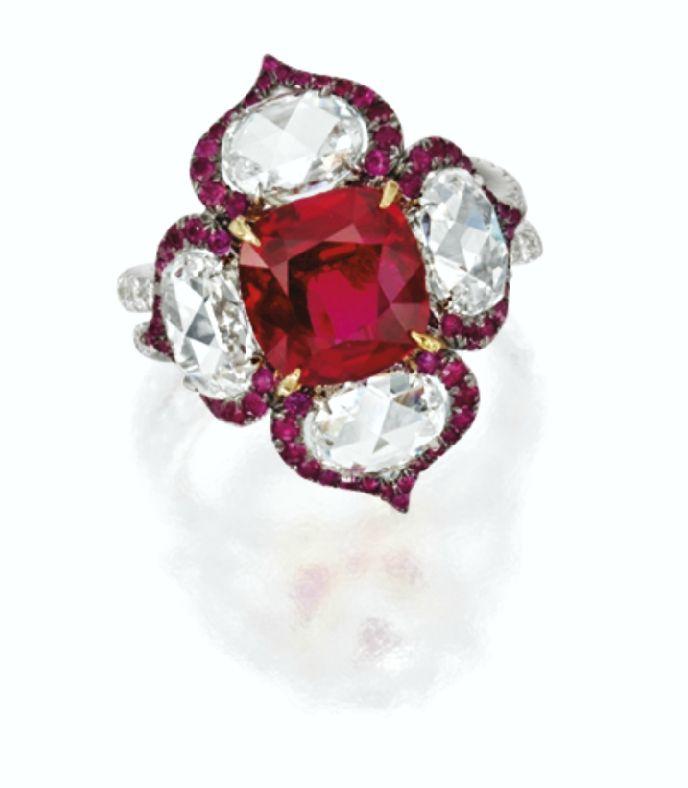 Cushion-shaped ruby and diamond ring. Via Southeby's.