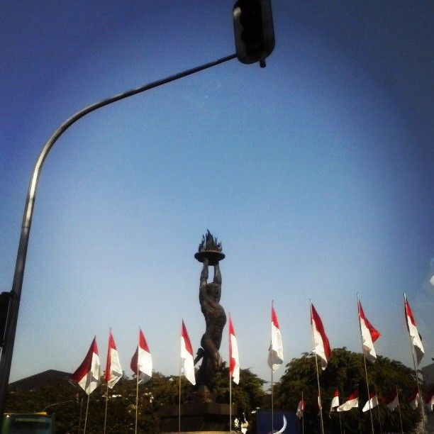 Captured this great Patung Pemuda under the red light on my way to office. Happy Independence Day, Indonesia! A day before August 17th, 2013.
