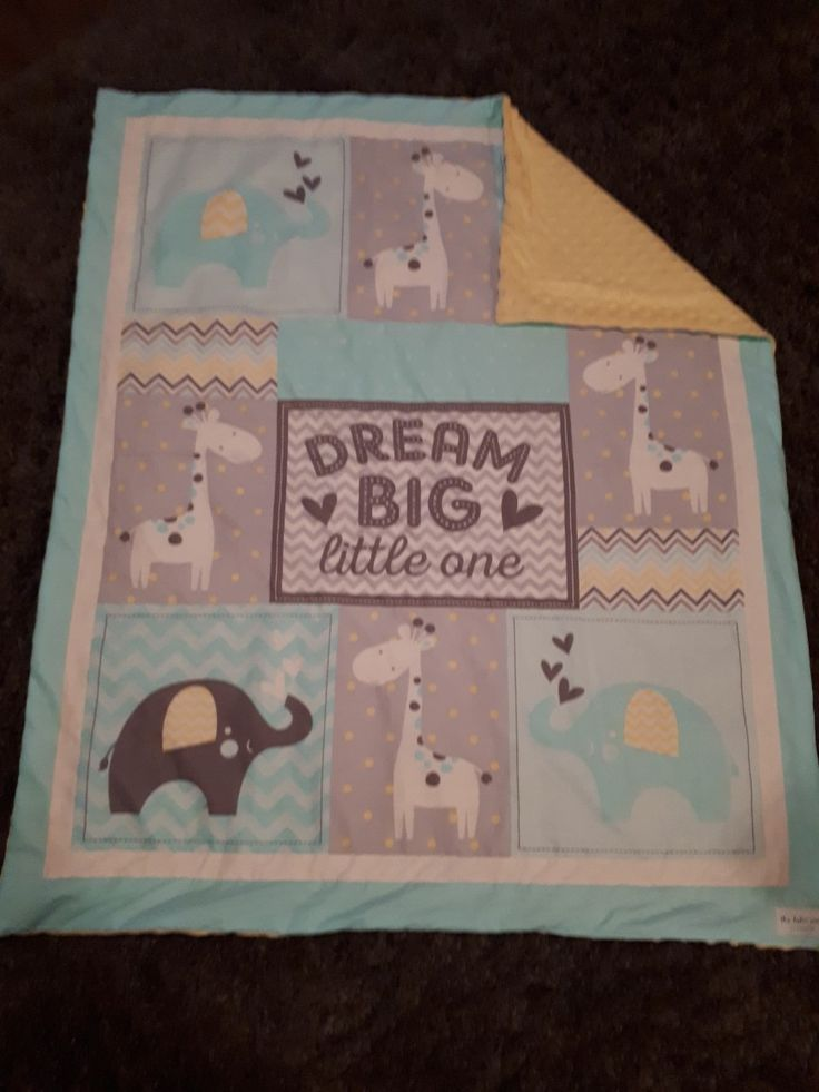 Cute blanket with yellow minky on the back sewn by 'this baker sews'