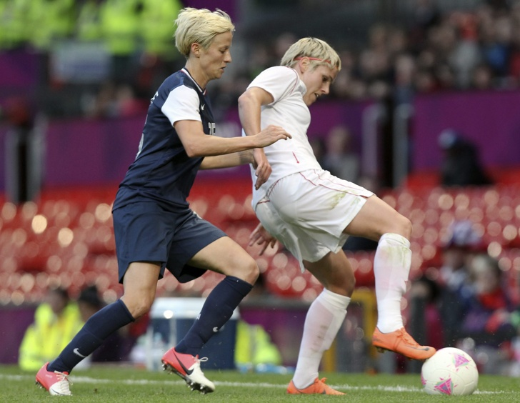 Canada's Sophie Schmidt (right) holds the ball against the United States in the women's soccer semifinal action in Manchester at the 2012 London Olympic Games, Monday, Aug. 6, 2012.   COC Photo: Mike Ridewood