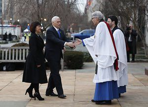 Rev. Luis Leon greets Vice President-elect Mike Pence and his wife Karen as they arrive for a church service at St. John's Episcopal Church across from the White House