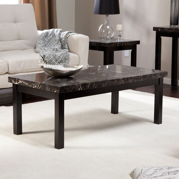 Galassia Faux Marble Coffee Table - The Galassia Coffee Table makes a regal centerpiece to your new living room or den collection. Featuring an alluring black faux marble top polished...
