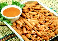 Lumpia Shanghai: Small, finger size Spring rolls filled with Shrimps, Meat, Garlic, and Spices, and deep fried to a crisp golden brown roll. It is served with a Sweet-sour sauce.