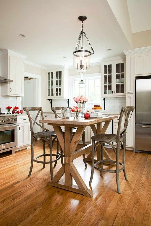 If you're short on space, consider swapping out your kitchen island for a tall table that will double as a prep surface and a space to enjoy your meals.