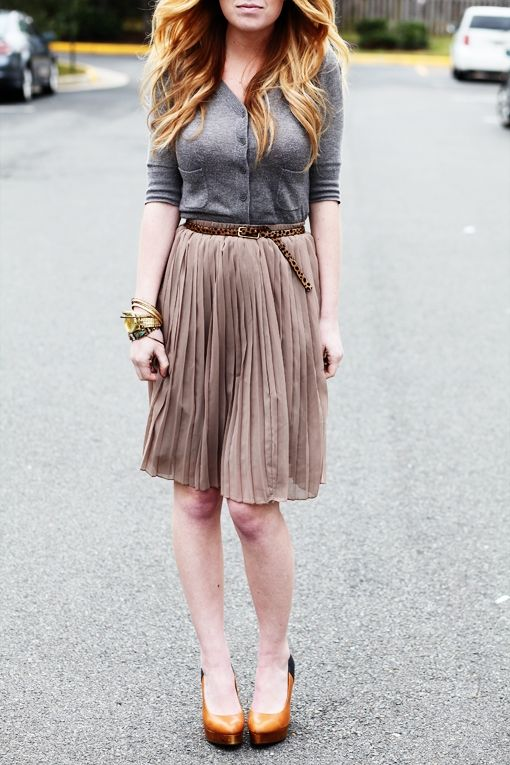 STYLE: Cardigan tucked into pleated skirt