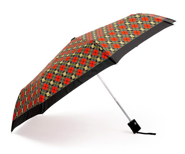 """Easy to carry in your bag, the Däv Rain Scot Compact Umbrella ($32) is the most petite of our picks — its 38-inch diameter shrinks to 10 inches in length when closed. (We evaluated even smaller subcompact umbrellas, but those fared poorly on durability tests.) In """"Scot"""" print only.  - GoodHousekeeping.com"""