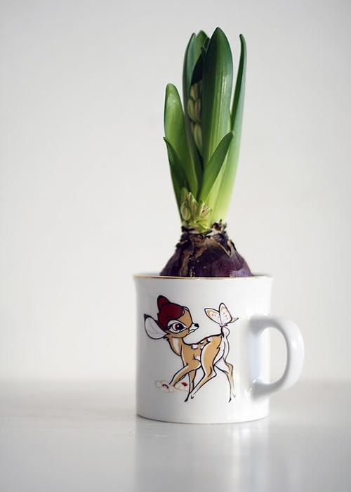 Vintage mug as plant pot