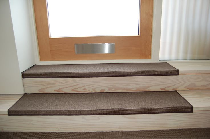 Mellau Sisal stair pads cut to a specific shape and size.