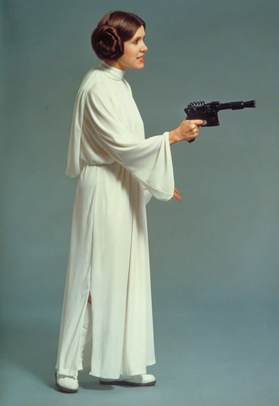 Star Wars (1977). Production still: Princess Leia (Carrie Fisher), side view of her icon white dress.