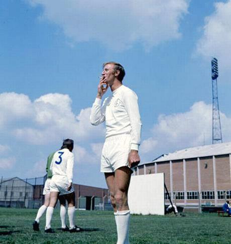 English footballer Jack Charlton smokes during Leeds United training, Leeds, England, 1970.