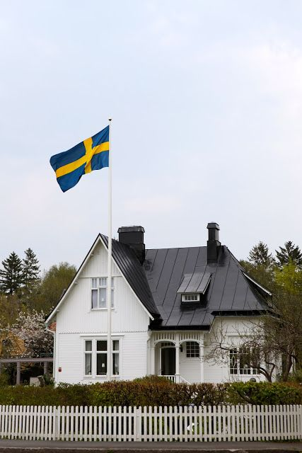 beautiful home in sweden with a proud swedish flag swaying in the wind. Can I live here?