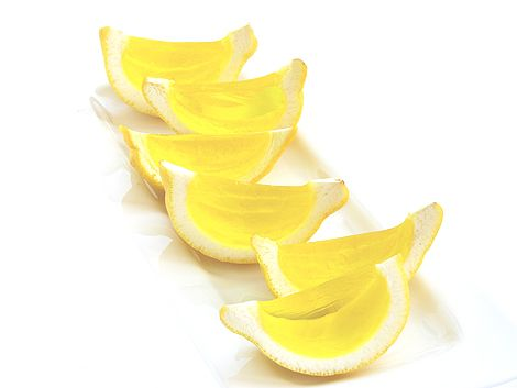 Lemon Drop Jell-O shots. Cool idea to use lemon wedges.