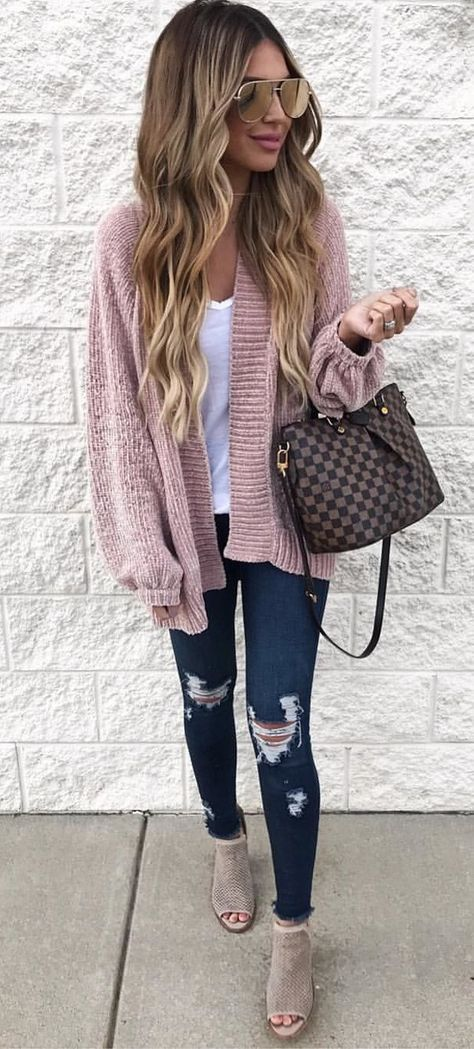 #fall #outfits women's in brown sweater jacket and white shirt with blue jeans and pair of brown pumps and brown and black two-way bag