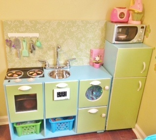 Kiddie Kitchen complete with stove/grill/oven, dishwasher, washer/dryer and refrigerator for the little chef