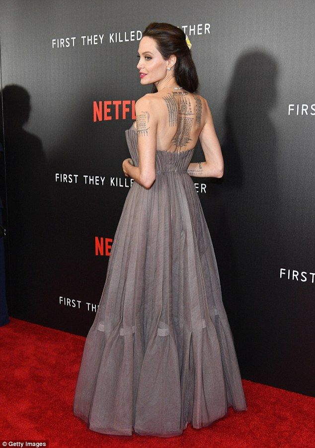 best angelina jolie images jolie pitt movie angelina jolie flaunts her famous ink in grey backless gown