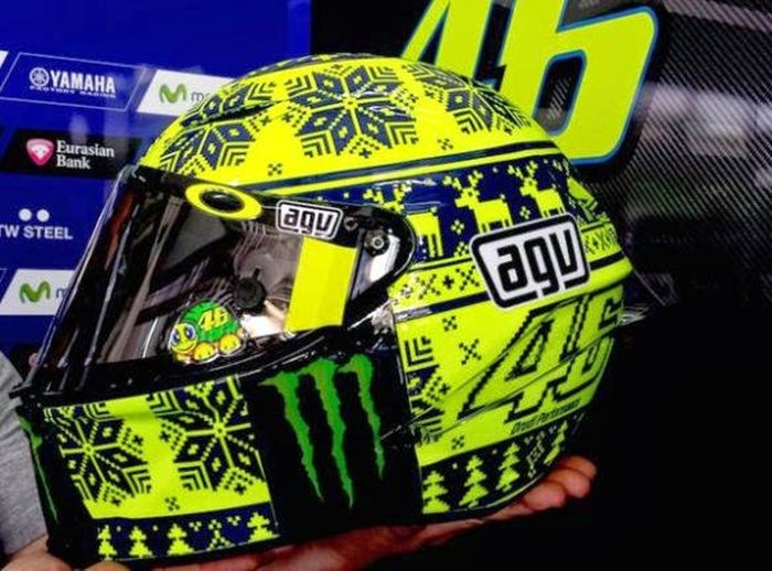Valentino Rossi 'Woolly Hat' helmet (Winter test 2015): For the 2015 Winter test that were held in Malaysia, Valentino Rossi reveled a new helmet design to poke fun at the tropical temperatures and oppressive heat that seemed ironic for an official 'Winter Test'.  The helmet was made to look like it was a knitted woolly hat and had chunky snowflakes, christmas trees, and reindeer on it. It was named the 'ugly sweater' helmet or the 'woolly hat' design, and you can see why.