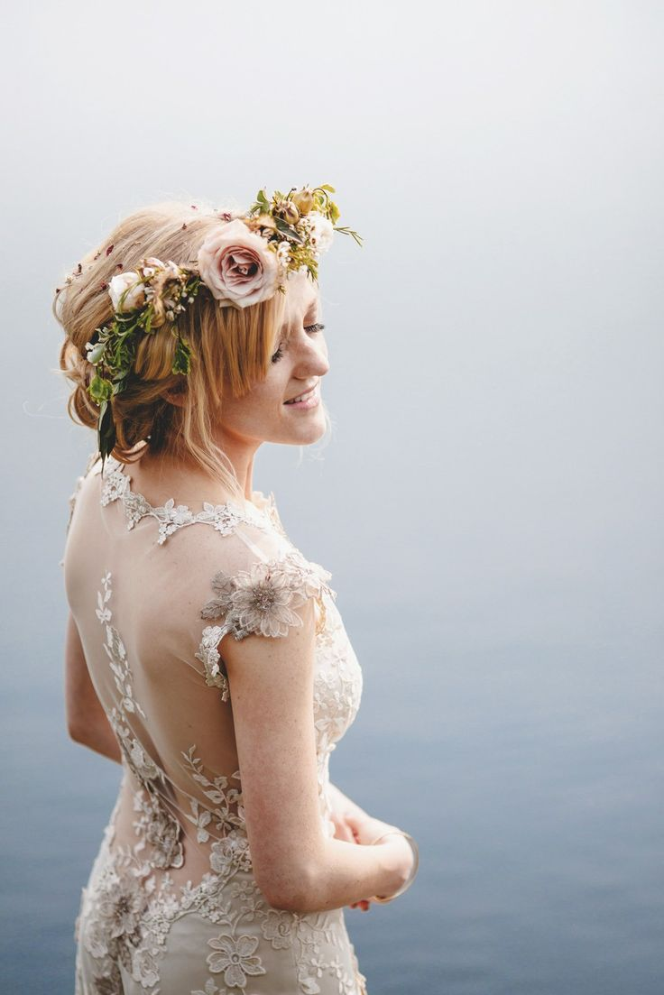 Bride wears a floral crown and Viola by Claire Pettibone for her Spring outdoor wedding - Photography by Ross Harvey