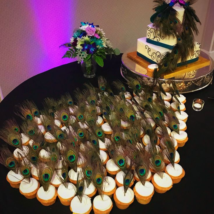 Peacock Feather Theme Wedding Cupcake and cake at Valley Forge Casino Resort Weddings #IDoVFCR