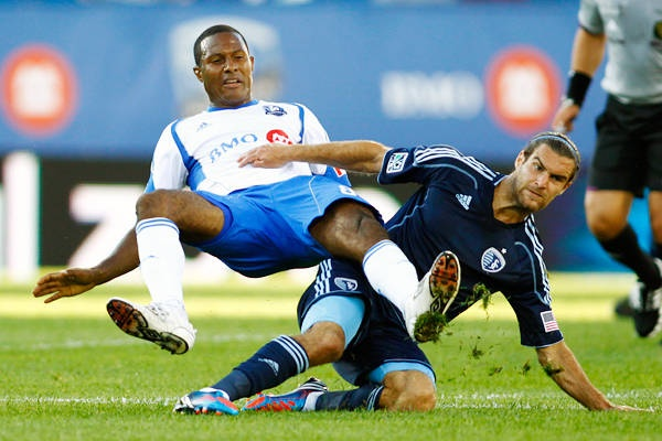 Sporting Kansas City's Graham Zusi (R) tackles Montreal Impact's Patrice Bernier during the first half of their MLS soccer match in Montreal, July 4, 2012.    REUTERS/Olivier Jean via Action Images - AP Images
