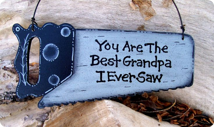 Best Grandpa Ornament.  I used an old saw with a wooden handle, painted it and wrote on it with a sharpie marker.  My girls also put their handprints on it with paint.