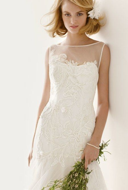 A pretty illusion neckline can also give the illusion of a larger chest. Style MS251035, tulle wedding dress with lace appliqués, $1,000, Melissa Sweet for David's Bridal See more Melissa Sweet for David's Bridal wedding dresses.