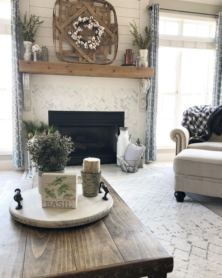 Living room, neutral decor, farmhouse style with Lazy Susan on coffee table.
