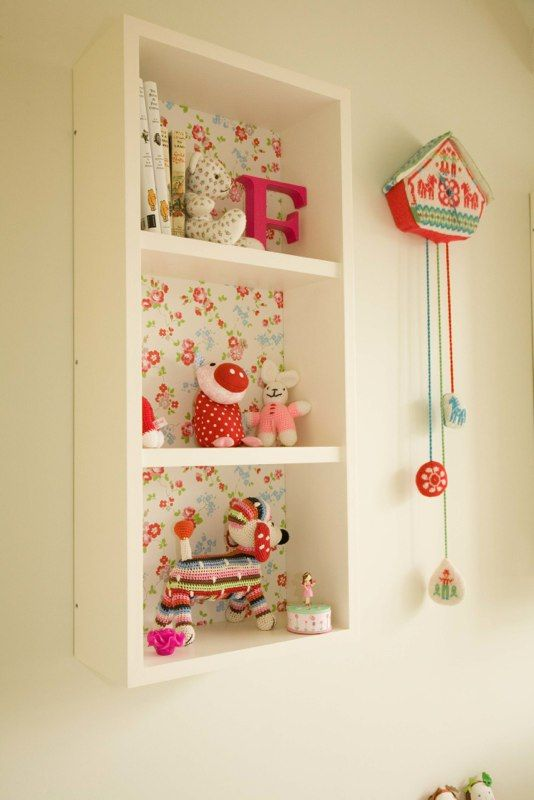 Children's bedrooms - love the wallpaper behind the shelves