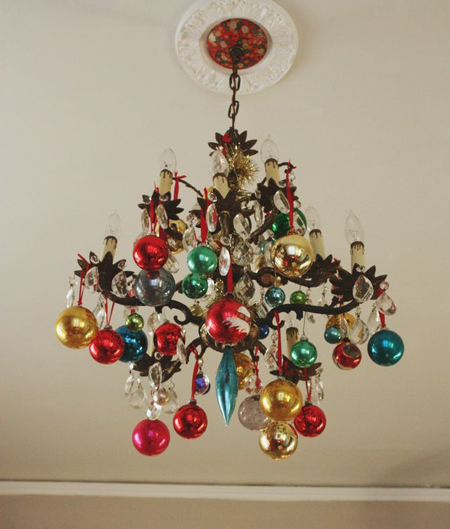 Decor Inspiration - retro ornaments hung with ribbon or wire hooks. Looks beautiful when the chandelier is on.
