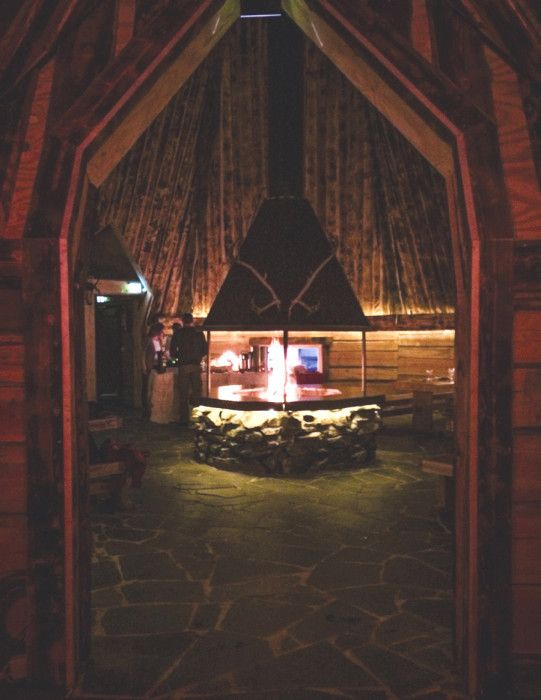 Savour your meal around the fireplace in our Lappish-style restaurant in the Santa Claus Village in Rovaniemi.