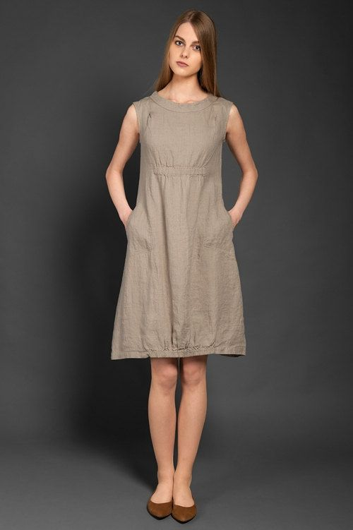 Light grey specially-washed 100% linen sleeveless dress with side pockets. An elasticated bottom part and area bellow the chest adds a delightfully playful touch to the dress. The special wash in the manufacturing process made the dress much softer as well as shrink-resistant. This knee-length linen dress will be a lovely and fun-looking garment, simply perfect for hot summer days. // €80