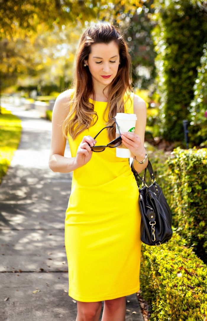 Create corporate sunshine with pops of bright color, like this gorgeous yellow dress.