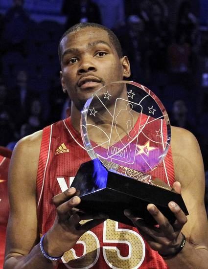 Western Conference's Kevin Durant, of the Oklahoma City Thunder, hoists the Most Valuable Player trophy following the NBA All-Star basketball game, Sunday, Feb. 26, 2012, in Orlando, Fla. The Western Conference won 152-149. (AP Photo/Chris O'Meara) ORG XMIT: DOA153
