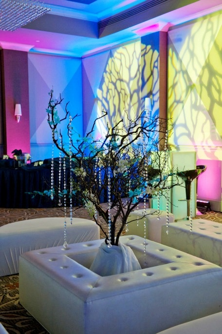 DA VINCI'S FLORIST transformed Lakewood Country Club's ballroom into a enchanted forest with beautiful flowers and lighting in hot pink and navy blue hues.