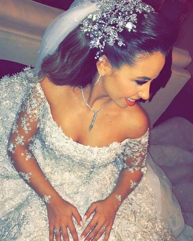 #HappeningNow  Today's bride wearing an astonishing @ramikadi gown  ______________ ▪Wedding planner : Baz events @bazevents . ▪Wedding dress : Rami kadi @ramikadi ▪floral decoration: Ikebana @ronibassil ▪Wedding venue : four seasons Beirut @fsbeirut . ▪Lighting: Prism @prismlebanon ▪Makeup artist: Elie stephan @eliestephan _______________ #LebaneseWeddings #hassanyara @yaraghabris