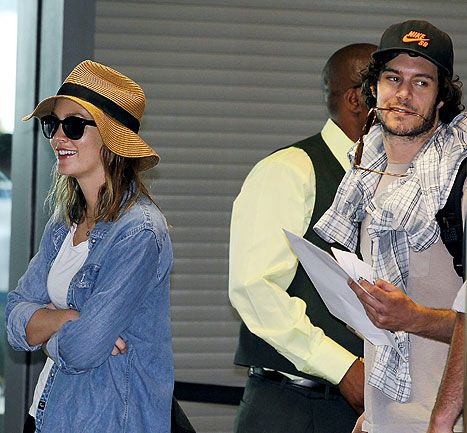 Leighton Meester kept her engagement ring hidden during a trip to Cape Town with fiance Adam Brody.