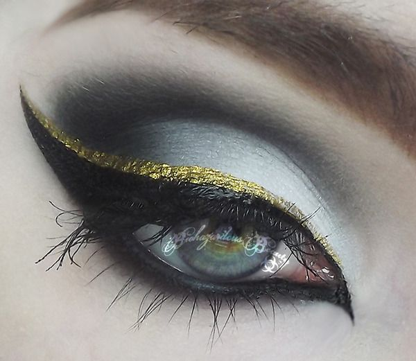 black and gold glitter liquid liner cat eye