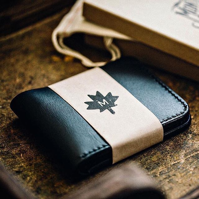 Montgomery Leather stamps strips of kraft for custom wallet packaging. #madewithlumi