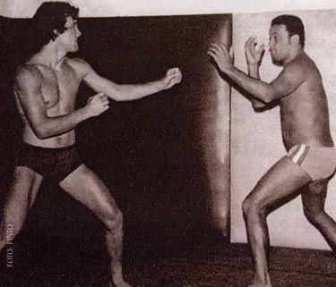 Rolls Gracie sparring with Carlson Gracie