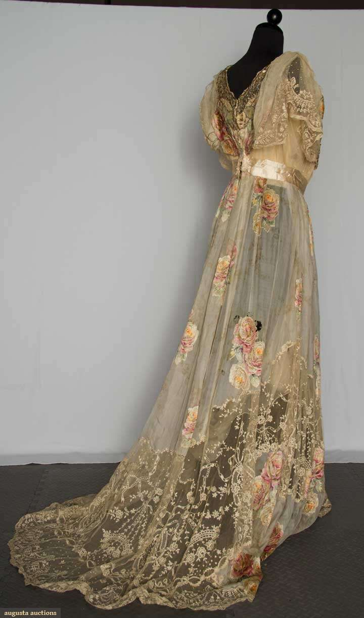 1900-1920 Cream silk chiffon with pale printed & flocked rose blossom clusters in soft colors, center front panel covered with iridescent sequins & metallic copper coils in floral motifs, embroidered net lace insets on bodice & at hem, chiffon lining.